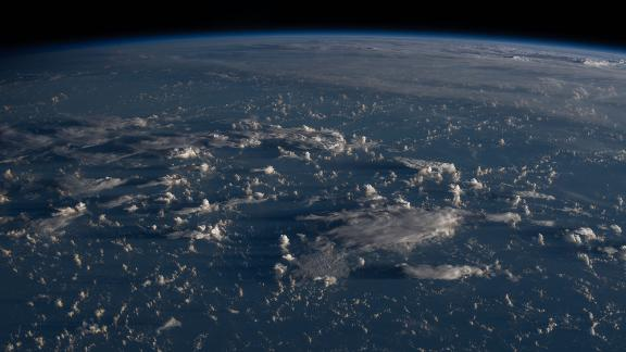 Sunrise casts long shadows from the clouds across the Philippine Sea as the International Space Station orbited about 200 miles east of Taiwan on July 13.