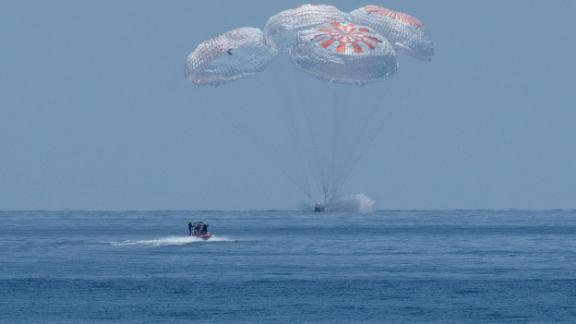 SpaceX's Crew Dragon spacecraft, carrying NASA astronauts Robert Behnken and Douglas Hurley, splashes down into the Gulf of Mexico on Sunday, August 2.