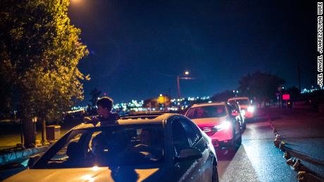 El Pasoans drove through Ascarate Park on Sunday to see a Luminarias honoring the victims of the shootout.