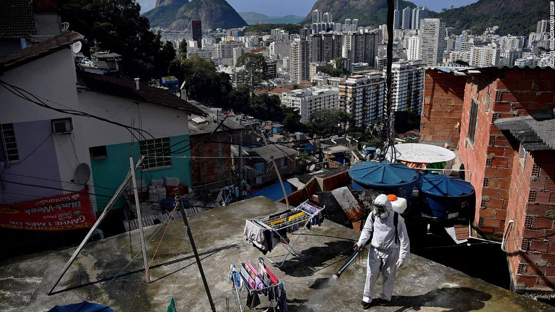 A volunteer disinfects a rooftop area in Rio de Janeiro on August 1.