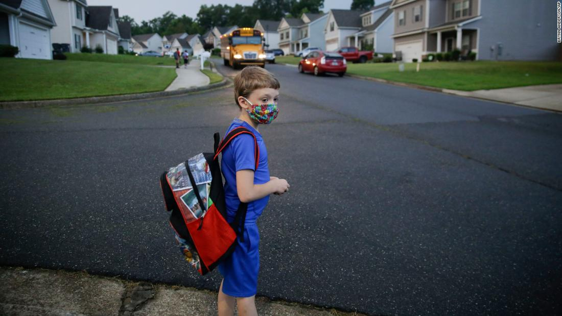 Paul Adamus, 7, waits at the bus stop for his first day of school in Dallas, Georgia, on August 3.