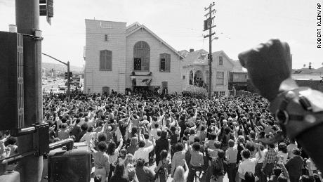 "About 1,500 mourners give the Black Panther salute as the body of ""Soledad Brother"" George Jackson was carried from St. Augustine's Episcopal Church in Oakland, California, in 1971."
