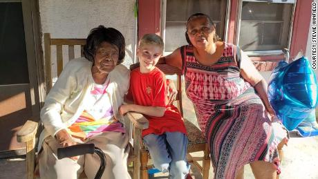Greyson with two seniors he gave a gift cards to for food.
