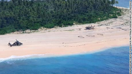 Three men from the Federated States of Micronesia on the beach of Pikelot Island, found after a combined US and Australian Search.Their SOS message outlined on a beach was spotted from the air by Australian and US aircraft searching the area.