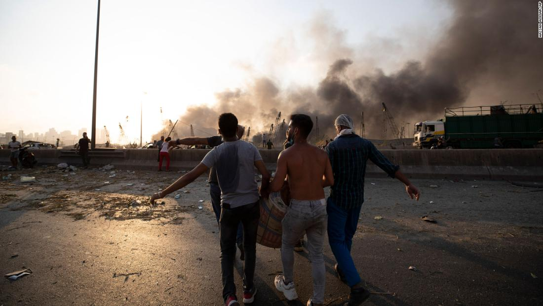 A wounded person is carried after the blast.