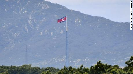 Photo taken July 14, 2020, from Paju, a South Korean city just south of the truce village of Panmunjeom, shows a North Korean flag. (Photo by Kyodo News via Getty Images)