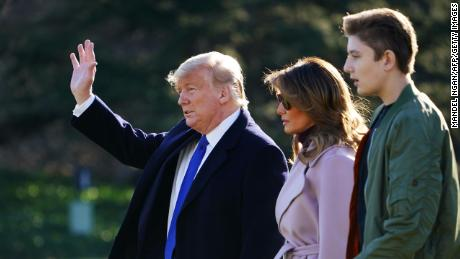 US President Donald Trump, First Lady Melania Trump and son Barron Trump make their way to board Marine One from the South Lawn of the White House in Washington, DC on January 17, 2020.