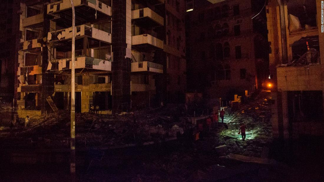 "Rescue crews search a street for survivors  on Tuesday night. ""People are asking the emergency department about their loved ones, and it is difficult to search at night because there is no electricity,"" Health Minister Hamad Hassan <a href=""https://www.cnn.com/middleeast/live-news/lebanon-beirut-explosion-live-updates-dle-intl/h_191ad60f239ae9b49e4332022ce8db8c"" target=""_blank"">told the Reuters news agency.</a> ""We are facing a real catastrophe and need time to assess the extent of damages."""