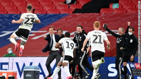 Joe Bryan celebrates after scoring Fulham's first goal.