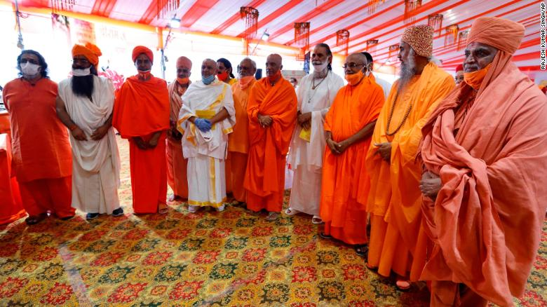 Hindu priests gather for a groundbreaking ceremony of a temple dedicated to the Hindu god Ram in Ayodhya, India,