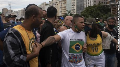 Supporters of Brazilian President Jair Messias Bolsonaro gather in support of him and to protest against racism and the death of blacks in the slums of Brazil during a Black Lives Matter protest on Copacabana beach in Rio de Janeiro on June 7, 2020.