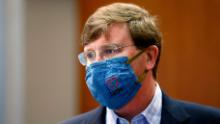 """Gov. Tate Reeves sports a """"Mississippi Strong"""" face mask following his coronavirus news briefing in Jackson, Miss., Wednesday, July 8, 2020. Reeves and other state officials provided reporters an update on the coronavirus and the state's ongoing strategy to limit transmission. (AP Photo/Rogelio V. Solis)"""