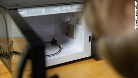 Dr. Michael Pecht of the University of Maryland's Center for Advanced Life Cycle Engineering looks at an AmazonBasics microwave from a customer who said it caught on fire.