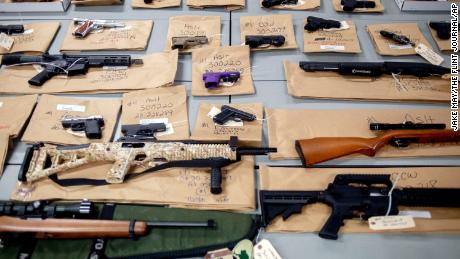 Some of more than 30 guns seized or recovered by Flint police in the last seven days, seen here during a press conference on Wednesday, July 29, 2020 at the Flint Police Department in Flint, Mich.  The city will stop gun auctions, choosing to instead destroy weapons that are seized or recovered by police officers. (Jake May/The Flint Journal via AP)