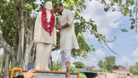Dushyant Singh pictured next to a statue of his grandfather, Raja Man Singh.