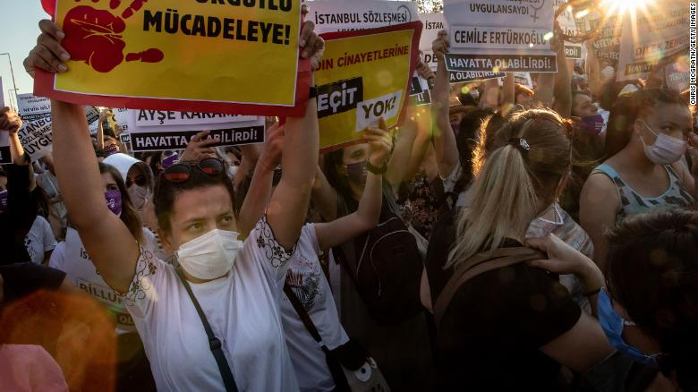 Women chant slogans and wave signs during the demonstration in Istanbul on Wednesday.
