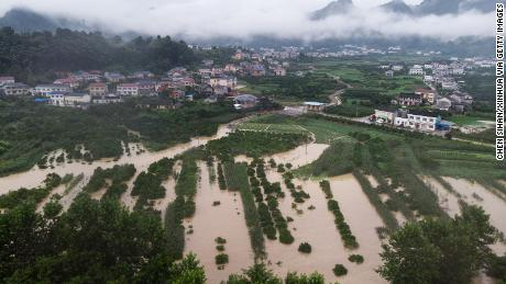 This aerial photo taken on July 6 shows flooded farmland in Shimen County, in central China's Hunan Province. The country has been hit by the worst flooding it has experienced in years.