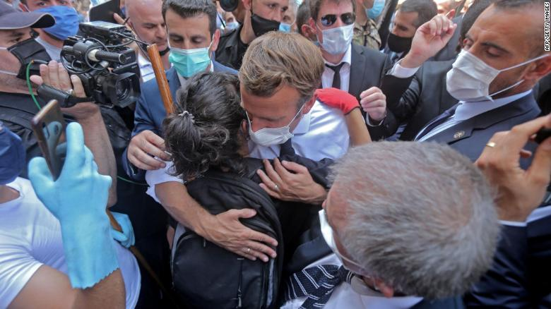 A Lebanese youth hugs Macron during  his visit to Gemmayzeh.