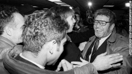Pete Hamill is greeted by colleagues from the New York Post, where he started working as a reporter in 1960.