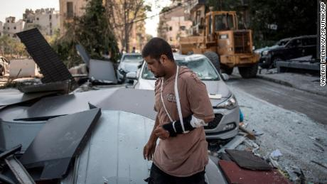 6301802 06.08.2020 A man with a cast on broken arm walks past damages after the massive explosion in Beirut, Lebanon. The blast hit Lebanese capital on August 4, with 137 people killed and some 5,000 injured. Valeriy Melnikov / Sputnik  via AP