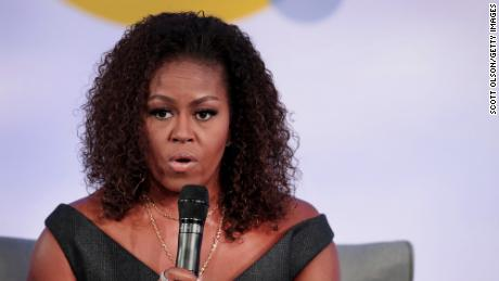 """CHICAGO, ILLINOIS - OCTOBER 29: Former first lady Michelle Obama speaks to guests at the Obama Foundation Summit at Illinois Institute of Technology on October 29, 2019 in Chicago, Illinois. The Summit is an annual event hosted by the Obama Foundation. The 2019 theme is """"Places Reveal Our Purpose"""". (Photo by Scott Olson/Getty Images)"""