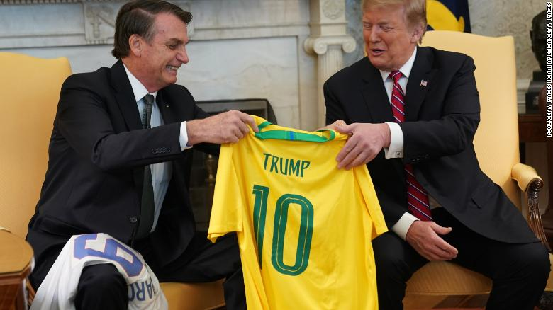 Brazilian President Jair Bolsonaro, left, presents US President Donald Trump with a Brazil national soccer team jersey at the White House on March 19, 2019 in Washington, DC.