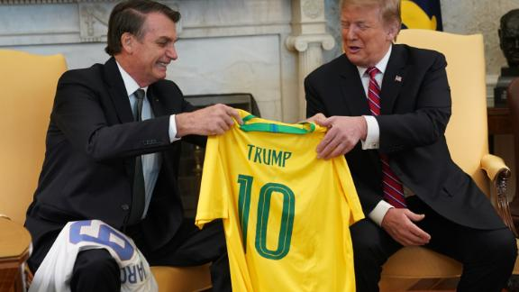 WASHINGTON, DC - MARCH 19: Brazilian President Jair Bolsonaro presents U.S. President Donald Trump with a Brazil national soccer team jersey Number 10 for striker position at the White House March 19, 2019 in Washington, DC. President Trump is hosting President Bolsonaro for a visit and bilateral talks at the White House today.  (Photo by Chris Kleponis-Pool/Getty Images)