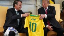 Brazilian President Jair Bolsonaro presents US President Donald Trump with a Brazil national team jersey at the White House March 19, 2019 in Washington, DC.