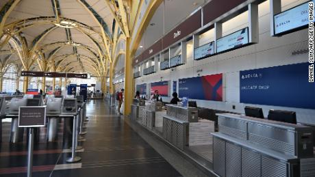 A view of empty Delta check-in counters at Washington National Airport (DCA) on April 11, 2020 in Arlington, Virginia. - Many flights are canceled due to the spread of the Coronavirus over the US. (Photo by Daniel Slim/AFP/Getty Images)