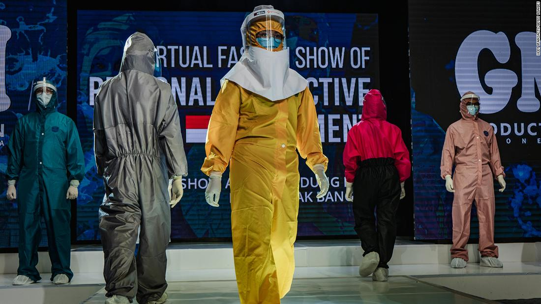 Medical workers in Yogyakarta, Indonesia, showcase designs during a fashion show of personal protective equipment on August 1. The fashion show was held as a form of gratitude for all medical personnel who have been fighting Covid-19.