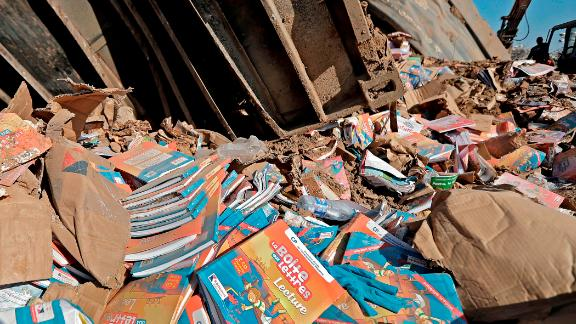 Books are seen in the blast debris on Friday.