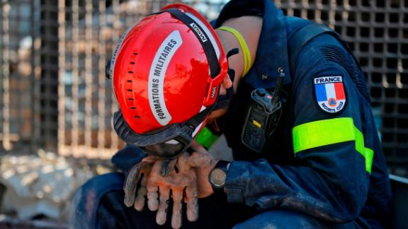 A French rescue worker rests on Friday.