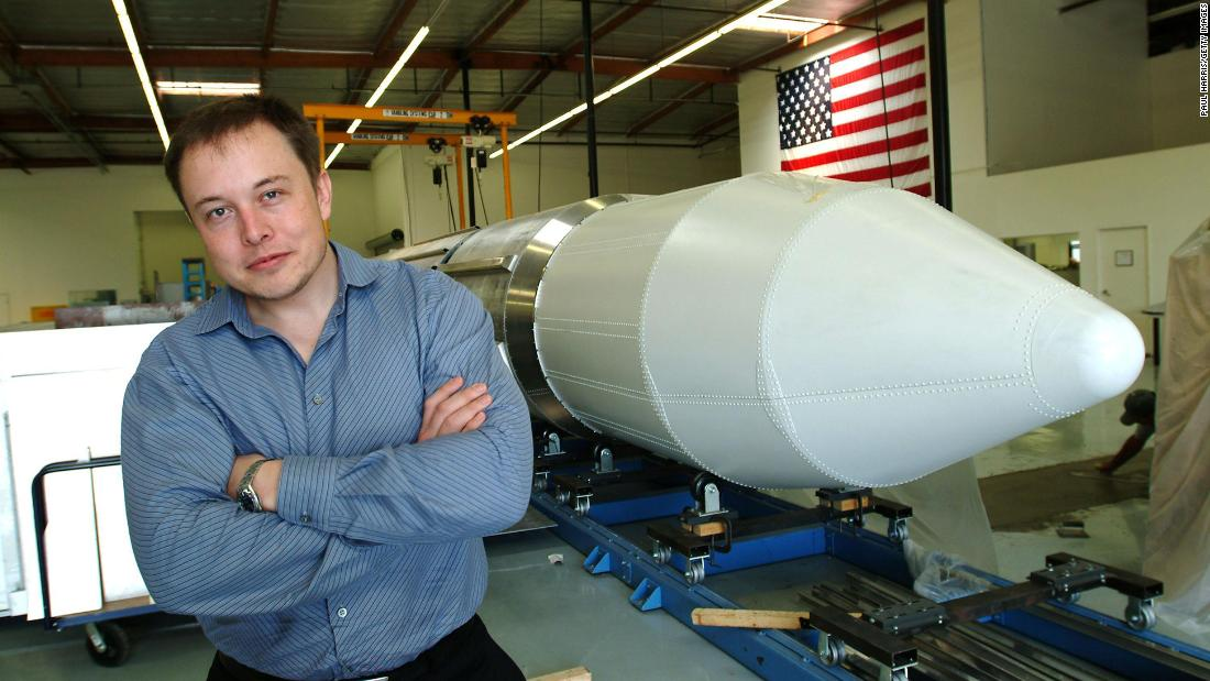 Elon Musk stands beside a rocket on March 19, 2004 in El Segundo, Los Angeles, California.