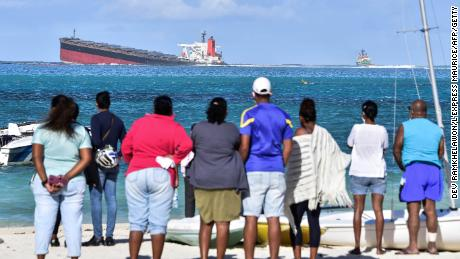 Bystanders look on near Blue Bay Marine Park on August 6.