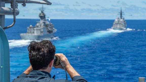 The Royal Australian Navy frigate HMAS Stuart, left, and the Japan Maritime Self-Defense Force destroyer JS Teruzuki are seen from the port bridge wing aboard the  guided-missile cruiser USS Antietam during a South China Sea exercise in July.