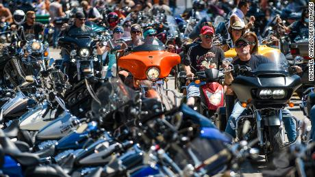 STURGIS, SD - AUGUST 07: Motorcyclists ride down Main Street during the 80th Annual Sturgis Motorcycle Rally on August 7, 2020 in Sturgis, South Dakota. While the rally usually attracts around 500,000 people, officials estimate that more than 250,000 people may still show up to this year's festival despite the coronavirus pandemic. (Photo by Michael Ciaglo/Getty Images)