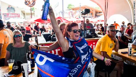 A woman wearing a Trump flag dances while watching a band perform at the 80th Sturgis Motorcycle Rally on Friday in Sturgis, South Dakota.