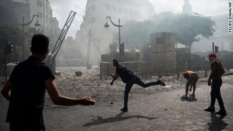 Mock gallows, tear gas and flying rocks. Beirut erupts in violent protest days after blast