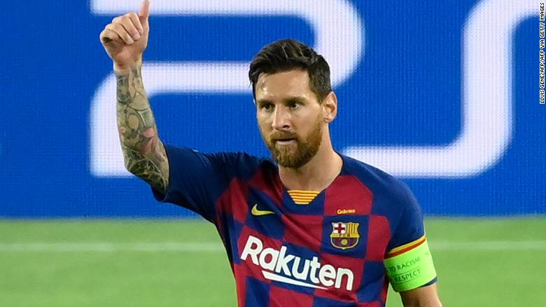 Lionel Messi celebrates after scoring Barcelona's brilliant second goal against Napoli in the Champions League last 16 second round tie in the Camp Nou.
