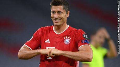 Robert Lewandowski celebrates after scoring his 52nd goal of the season to put his side Bayern Munich ahead from the penalty spot during the Champions League round of 16 second leg match against Chelsea.