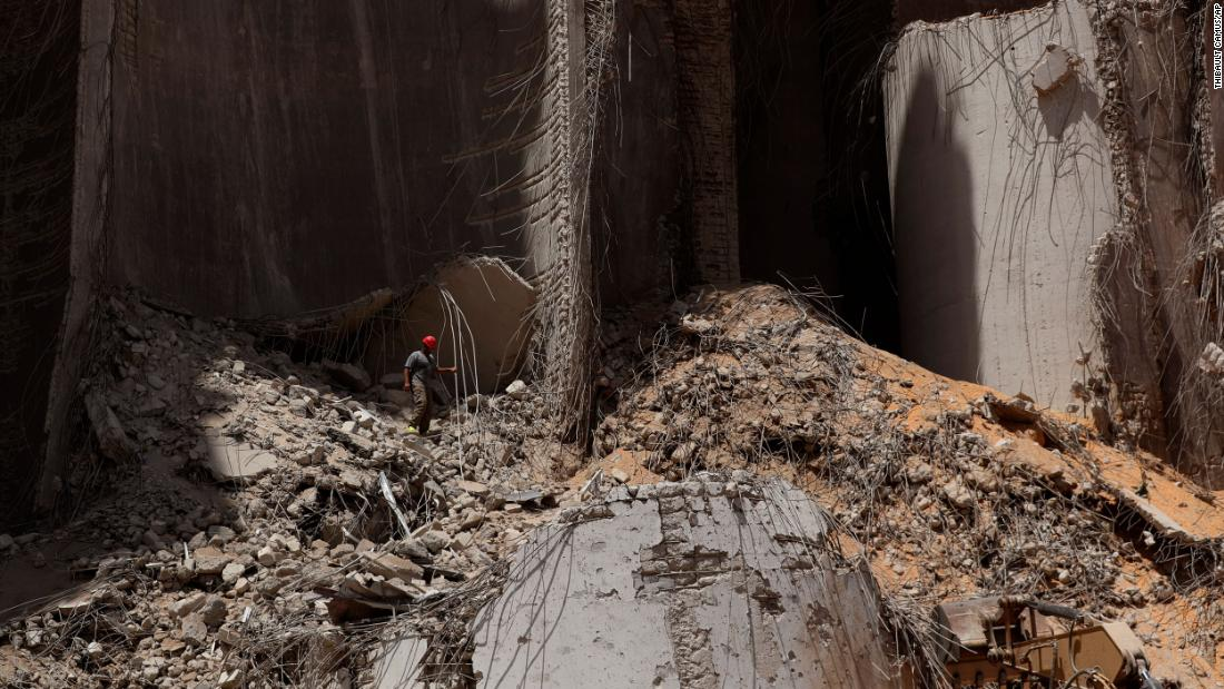 A rescue worker walks along a pile of rubble at the explosion site in Beirut, Lebanon, on Saturday, August 8.