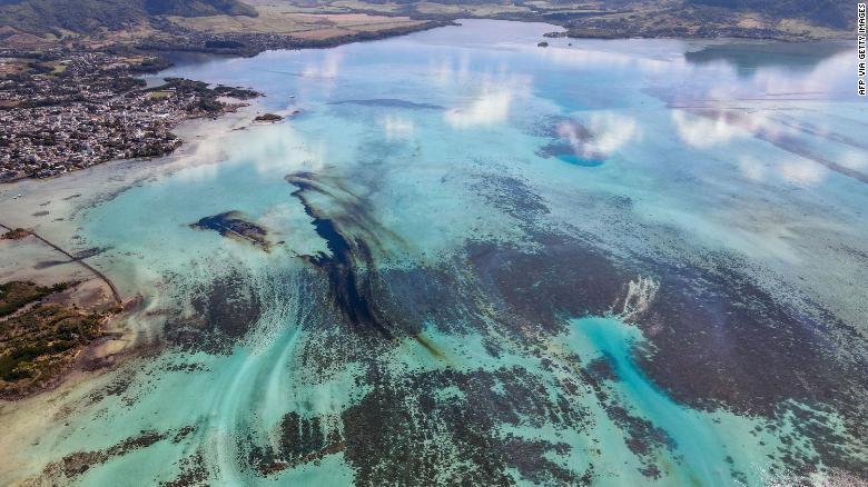 An aerial view shows a large patch of leaked oil from the stricken vessel near Blue Bay Marine Park.