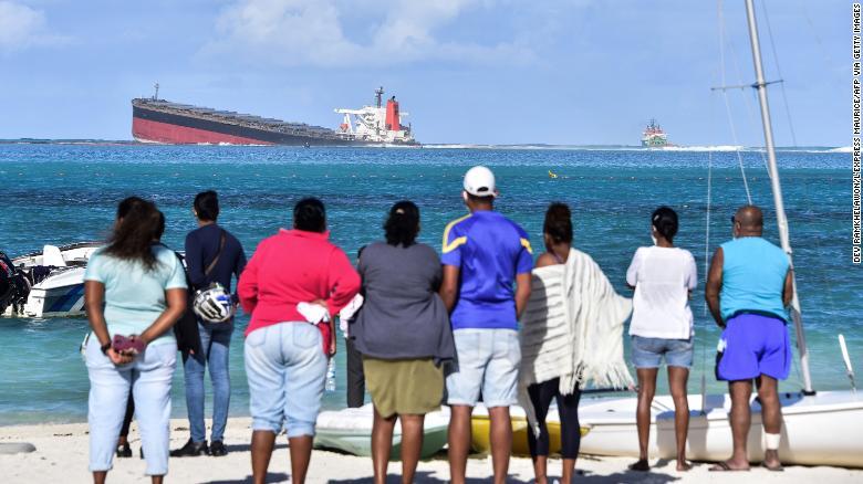 Bystanders look at MV Wakashio near Blue Bay Marine Park in Mauritius.