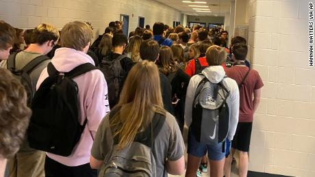 CORRECTS SPELLING OF LAST NAME TO WATTERS, NOT WATERS - FILE - In this photo posted on Twitter, students crowd a hallway, Tuesday, Aug. 4, 2020, at North Paulding High School in Dallas, Ga. The Georgia high school student says she has been suspended for five days because of photos of crowded conditions that she provided to The Associated Press and other news organizations. Hannah Watters, a 15-year-old sophomore at North Paulding High School, says she and her family view the suspension as overly harsh and are appealing it. (Twitter via AP, File)