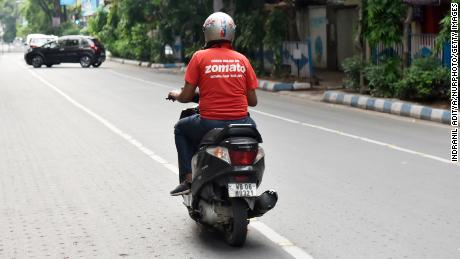 A Zomato food delivery man on a two wheeler during a government-imposed nationwide lockdown in Kolkata, India on May 7, 2020.