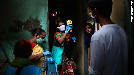 A health worker screens people for Covid-19 symptoms at Dharavi, one of Asia's biggest slums, in Mumbai, India.