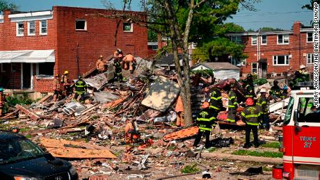 Firefighters at the scene of where homes were destroyed.