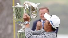 Morikawa reacts as the lid to the Wanamaker Trophy falls off during the trophy presentation after the 2020 PGA Championship.