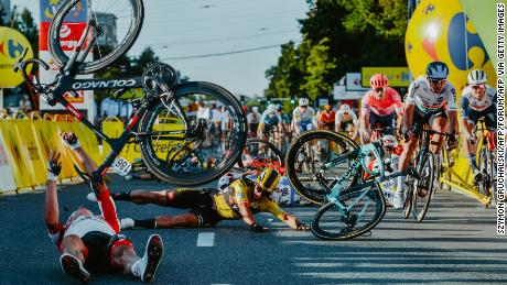 Dutch cyclist Dylan Groenewegen (on the ground, center) and fellow riders collide during the opening stage of the Tour of Poland.