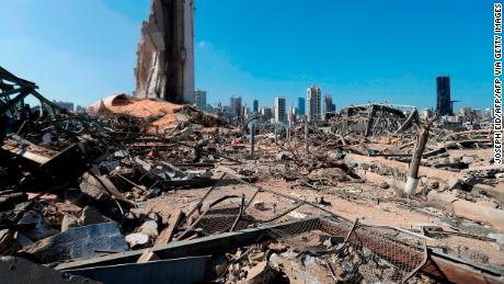 TOPSHOT - A picture shows the devastated Beirut port on August 7, 2020, three days after a massive blast there shook the Lebanese capital. - The explosion of a huge pile of ammonium nitrate that had languished for years in a port warehouse served as shocking proof to many Lebanese of the rot at the core of their system, with seething anti-government protests erupting late Thursday near parliament. World leaders have joined the chorus of Lebanese in the country and abroad demanding an international probe into a blast that killed nearly 150 and wounded at least 5,000 people. At least 300,000 were left temporarily homeless, including nearly 80,000 children, the United Nations' child agency has said, warning that many have been separated from their families. (Photo by JOSEPH EID / AFP) (Photo by JOSEPH EID/AFP via Getty Images)